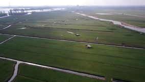 Decending video of meadow in reclaimed land with second world war bunkers
