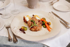 Decent piece of meat on beige porcelain plate Royalty Free Stock Photo