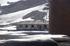 Deception Island Ruins - Antarctica. The ruins of the old whaling station (historic - Biscoe House) and world war II fuel tanks at Deception Island, an active stock image