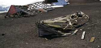 Deception Island Ruins - Antarctica. The ruins of the old whaling station building and whaling boat at Deception Island, an active volcano in the Antarctica area royalty free stock photos