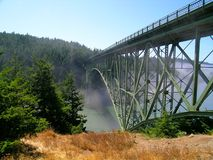 Deception Pass Bridge. Mist rolling under Deception Pass Bridge linking Whidbey and Fidalgo Islands in Northwest Washington state Royalty Free Stock Photos