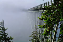 Deception Pass Bridge in fog. Arch bridge in Deception Pass State Park. Puget Sound. Juan de Fuca Strait. Whidbey Island. Seattle. Washington. United States stock photo