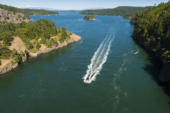 Deception Pass State Park, Washington. Rugged cliffs drop to meet the turbulent waters of Deception Pass. The park is known for its breath-taking views, old stock images