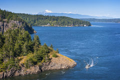 Deception Pass State Park, Washington. Rugged cliffs drop to meet the turbulent waters of Deception Pass. The park is known for its breath-taking views, old stock photo