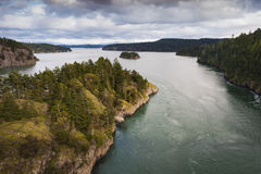 Deception Pass, Washington. Deception Pass is a strait separating Whidbey Island from Fidalgo Island, in the northwest part of the U.S. state of Washington. The stock photo