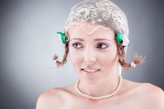 Decicing cute young bride biting her lips Stock Photography