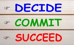 Decide commit succeed concept. DECIDE, COMMIT and SUCCEED written on wood wall decor. Motivation concept royalty free stock photo
