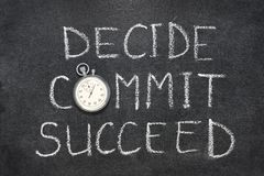 Decide, commit, succeed. Words handwritten on chalkboard with vintage precise stopwatch used instead of O stock images
