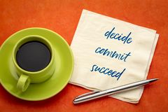 Decide, commit, succeed word abstract. Handwriting on a napkin with a cup of coffee stock photo