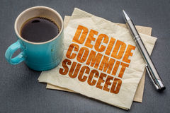 Decide, commit, succeed word abstract. Decide, commit, succeed motivational word abstract on a napkin with cup of coffee against gray slate stone background royalty free stock images