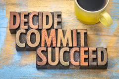 Decide, commit, succeed word abstract. In vintage letterpress wood type with a cup of coffee royalty free stock photo