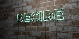 DECIDE - Glowing Neon Sign on stonework wall - 3D rendered royalty free stock illustration Royalty Free Stock Photography