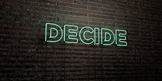 DECIDE -Realistic Neon Sign on Brick Wall background - 3D rendered royalty free stock image Royalty Free Stock Photo