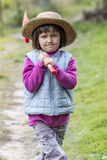 Decided preschooler walking on garden path with shovel on shoulder Royalty Free Stock Photos