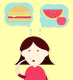 Deciding the diet. Girl thinking and deciding to eat a sandwich or fruit Stock Image