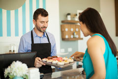 Deciding what cupcake to get Stock Photography