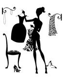 Deciding What to Wear. Silhouette fashion illustration of a girl in her boudoir choosing an outfit Stock Photo