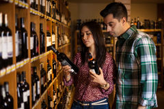 Deciding which kind of wine to buy Stock Photo