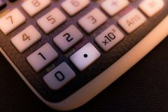 Decimal point key from the keyboard of a scientific calculator. Machine stock photography
