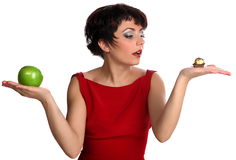 Decision. Beautiful woman on red with apple Royalty Free Stock Image