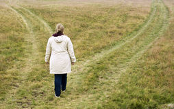 Decision. Woman standing at crossroad, choosing path, concept of decision process Stock Photography