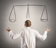 Decision. Of a businessman with a drawing of balance stock images