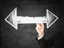 Decision. Businessman with pen drawing arrows pointing left and right - decision or strategy concept Stock Photography