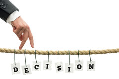 Decision. Businessman walking his fingers along a frayed rope with sign Decision hanging off it stock images