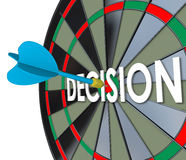 Decision Choice Final Judgment Determination Dart Board Bull's E. Decision word in 3d letters on a dart board and a direct hit on the bull's eye to illustrate an Royalty Free Stock Images