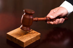 The decision of destiny. A hand holding a gavel Stock Photography