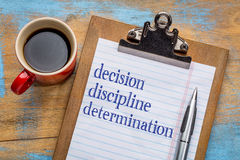Decision, discipline, and determination. Words  on a clipboard with a cup of coffee - motivational tips for achieving goals and success Stock Photos
