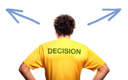 Decision maker. A picture of the back of a young man standing against white background and trying to make decision Royalty Free Stock Images
