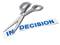 Decision Maker, Decisive Choice. Scissors cut the word indecision in two parts, the first one with the suffix in and the second one with the word decision Stock Photography