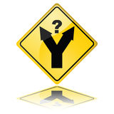 Decision making. Concept illustration of a traffic sign showing a fork in the road, with a question mark meaning a decision has to be made Royalty Free Stock Photo