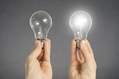 Decision making concept, hands with light bulbs Stock Images