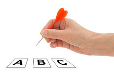 Decision making, female hand with dart and options. Stock Images
