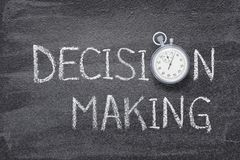 Decision making watch. Decision making phrase written on chalkboard with vintage stopwatch used instead of O stock photography