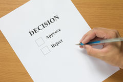 Decision paper wait for check on wood table Royalty Free Stock Images