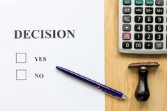 Decision paper with yes and no choice, pen, rubber stamp stock images