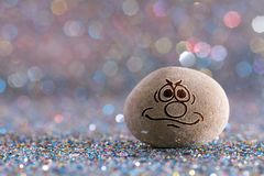 The decision stone emoji. Emotions on color glitter boke background royalty free stock photos