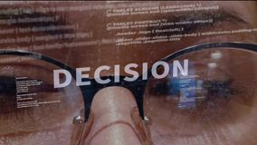 Decision text on background of developer. Decision text on the background of female software developer. Eyes of woman with glasses are looking at programming stock video footage