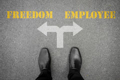 Decision to make at the cross road - freedom or employee Stock Photography