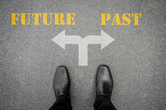 Decision to make at the cross road - future or past. Black shoes has decision to make at the cross road - future or past Royalty Free Stock Image
