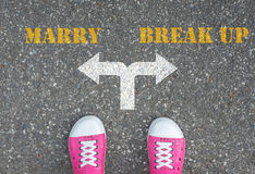 Decision to make at the cross road - marry or break up. Shoes has decision to make at the cross road - marry or break up Royalty Free Stock Image
