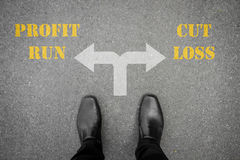 Decision to make at the cross road - profit run or cut loss Stock Photography