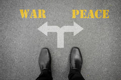 Decision to make at the cross road - war or peace Royalty Free Stock Images