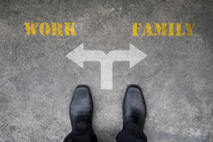 Decision to make at the cross road - work or family Royalty Free Stock Photo