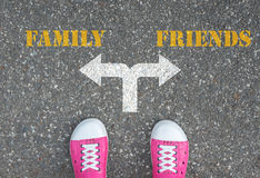 Decision to make at the crossroad - family or friends. One standing at the crossroad choosing what to do next - family or friends Royalty Free Stock Photography