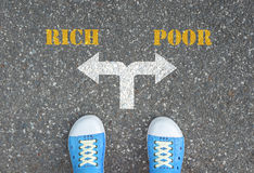 Decision to make at the crossroad - rich or poor. One standing at the crossroad choosing what to do next - rich or poor royalty free stock photography