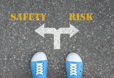 Decision to make at the crossroad - safety or risk Stock Photography